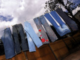 High Priced Jeans Hanging on a Line Premium Photographic Print by Ted Thai