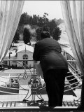 Suit Clad Movie Director Alfred Hitchcock as He Leans on Balcony Railing of Apartment Metal Print by Peter Stackpole
