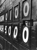 Boy Running Scoreboard at Griffith Stadium During the Baseball Game Photographie par Hank Walker