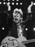 Guitarist for Stray Cats Rock Group Brian Setzer with Guitar, Screaming Song on Stage Premium Photographic Print by Kevin Winter