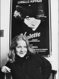 Isabelle Huppert Posing in Front of Movie Poster of Violette Premium Photographic Print by Ted Thai