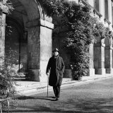 Scholar C.S. Lewis Walking with Cane Near Building at Magdalen College, Oxford University Premium Photographic Print by Hans Wild