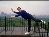 Comedian Jerry Seinfeld Acting Silly on His Apartment Building Rooftop Overlooking Central Park Premium Photographic Print by Ted Thai