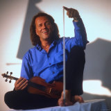 Dutch Violinist Andre Rieu Relaxing, Taking Practice Break with Violin Premium Photographic Print by Ted Thai