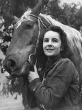 """Actress Elizabeth Taylor with Saddle Horse After Her Smash Movie Debut in """"National Velvet"""" Premium Photographic Print by Peter Stackpole"""