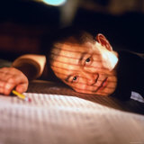 Chinese Born Composer Tan Dun Taking Break from Working, Resting His Head on Scores Premium Photographic Print by Ted Thai