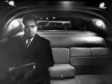 VP Richard Nixon Sitting Solemnly in Back Seat of Dimly Lit Limousine Photographie par Hank Walker