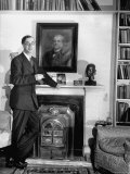 Biologist Dr. Julian Huxley Standing Beside His Fireplace, Photographic Print