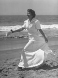 Claudette Colbert in Zippered, Terry Cloth Beach Robe, Sashaying Along Surf at Santa Monica Beach Premium Photographic Print by Peter Stackpole