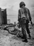 American Soldier Standing over Bodies of Japanese Attackers on Buna Beach Premium Photographic Print by George Strock