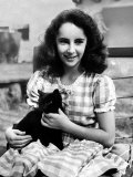 13 Year Old Actress Elizabeth Taylor Outside, Holding One of Her Many Pets, a Black Cat Named Jill Premium Photographic Print by Peter Stackpole