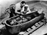 Archaeologist Howard Carter Examining Coffin of Tutankhamen, with 14th Century Egyptian Pharaoh Premium Photographic Print