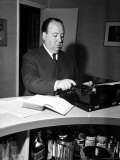 Movie Director Alfred Hitchcock Typing Script on a Portable Typewriter Premium Photographic Print by Peter Stackpole