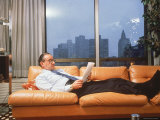 Fed. Reserve Bd. Chairman Appointee Alan Greenspan Stretched Out on Couch in His Apartment Premium Photographic Print by Ted Thai