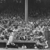 Yankee Mickey Mantle in Action, Swinging Bat with Catcher and Umpire Behind Him Premium-Fotodruck von Grey Villet