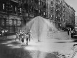 Children Running Around under Sprinkler in Street to Cool Off During Summer, in South Harlem Photographic Print