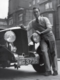 Richard Todd Leaning on Front of Car Premium Photographic Print by William Sumits