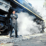 Country Music Star Johnny Cash Wearing Black Clothing and Standing in Front of a Locomotive Premium Photographic Print by Michael Rougier