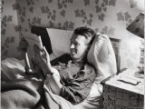 Jimmy Stewart, Dressed in Silk Pajamas Reading Magazine in Bed in Family Home Premium Photographic Print by Peter Stackpole