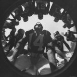 Eddie Lebaron of the Washington Redskins Huddling with His Teammates During a Game Premium Photographic Print by Hank Walker