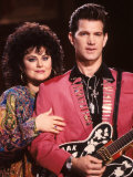 Delta Burke and Singer Chris Isaak Premium Photographic Print