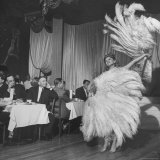 Customers at Sally Rand's Nightclub Watching a Dancer Performing the Midnight Fan Dance Premium Photographic Print by Charles E. Steinheimer