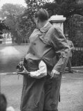 Wearing Coat with Second Man Buttoned Inside, Giving Weird Effect of Two Armed Man Holding Camera Premium Photographic Print by Hank Walker