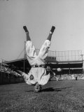 Baseball Clown John Price Fielding Ball While Standing on His Head Premium Photographic Print by Charles E. Steinheimer