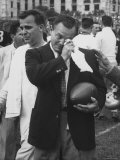 Football Coach Jack Freeman Holding Ball Weeps with Joy After His Team Photographic Print by Hank Walker