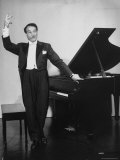 Comedian Pianist Victor Borge, in White Tie and Tails, Standing at Piano and Making Funny Faces Premium Photographic Print by Peter Stackpole