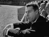 Ex Yankee Baseball Player Joe DiMaggio, Leaning over Rail Watching 3rd Game of the World Series Premium Photographic Print by Grey Villet