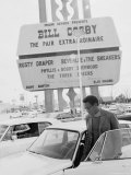 Comedian Bill Cosby Getting Into Car in Front of Sands Hotel Marquee with His Name on It Premium Photographic Print by Michael Rougier