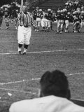 Referee, Dave Kaufman, going to Navy Sidelines to tell there is 4 minutes Remaining in 4th Quarter Premium Photographic Print by Hank Walker