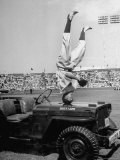 Baseball Clown John Price Standing on His Head on Hood of Jeep Premium Photographic Print by Charles E. Steinheimer