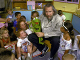 "Jim Henson with Muppet, Kids at Jim Henson Productions Townhouse, Promote ""Reading is Fundamental"" Premium Photographic Print by Ted Thai"