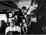 Freedom Riders Julia Aaron and David Dennis on Interstate Bus from Montgomery, AL to Jackson, MS Premium Photographic Print by Paul Schutzer