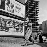 "Boys Playing Stickball in Vacant Lot Next to Drake's Cake and Movie ""Carnegie Hall"" Photographic Print by Ralph Morse"