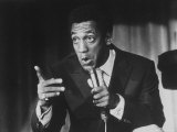 Comedian Bill Cosby Holding Mike as He Performs on Stage Premium Photographic Print by Michael Rougier
