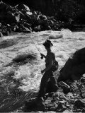 Country Dr. Ernest Ceriani Casting into Colorado River to Catch a Few Trout Photographie par W. Eugene Smith