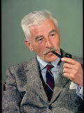 William Faulkner Smoking a Pipe Premium Photographic Print by Carl Mydans