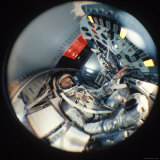 Fisheye View of Project Mercury Astronaut John Glenn in Mock Space Capsule, Location Unknown Premium Photographic Print by Ralph Morse