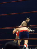 Boxers Cassius Clay and Oscar Bonavena Fighting at Madison Square Garden Premium Photographic Print by Bill Ray
