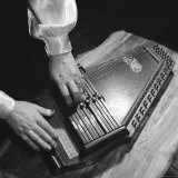 Hands of Sara Carter of the Legendary Carter Family Musicians, Fingering an Autoharp Premium Photographic Print by Eric Schaal