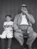 Brooklyn Dodgers General Manager Branch Rickey Sitting with Grandson Watching Spring Training Reproduction photographique sur papier de qualité par George Silk