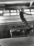 Jean Babilee, Star of Ballets Des Champs Elysees, Leaping During Practice as Other Dancers Watch Premium-Fotodruck von Gjon Mili