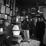 Woody Guthrie Playing in McSorley's Pub Premium Photographic Print by Eric Schaal