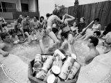 "Pair of Couples ""Chicken Fighting"" in a Crowded Jacuzzi Pool During a Beer Fueled Party Premium Photographic Print by Arthur Schatz"