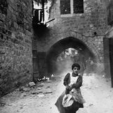 Jewish Girl, Rachel Levy, Fleeing from Street with Burning Buildings as Arabs Sack the Holy City Photographic Print by John Phillips