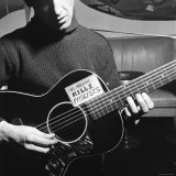 Folk Singer Woody Guthrie Playing Guitar with Sign on It Reading This Machine Kills Fascists Premium Photographic Print by Eric Schaal