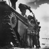 "Wounded American Marine Being Loaded Onto ""Alligator"" Tracked Amphibious Vehicle for Evacuation Photographic Print by W. Eugene Smith"